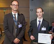 Chris Howcroft receiving his award from Michael Schoenwetter, Head of Research and Technology Partnerships at Airbus  Image by courtesy of Airbus
