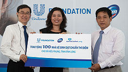World Toilet Day 2012 CEO of World Toilet Organisation Mr. Jack Sim, Marketing Vice President of Unilever Vietnam Ms. Nguyen Thi Bich Va and Chief of Staff Vinh Long Peoples Commitee Mr. Nguyen Hoang Hoc hold a cheque at the Media Briefing for World Toilet Day 2012, Vinh Long Province, Vietnam.