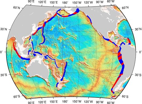 Map showing subduction zones and oceanic fracture zones. The blue bands are subduction interfaces – the parts of the subduction zone where the subducting plates are physically 'grinding' against the overriding plates. Coloured in red are the areas where oceanic fracture zones intersect these interfaces, which have higher probability of generating great earthquakes.
