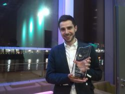 Image shows Pawel with his award.