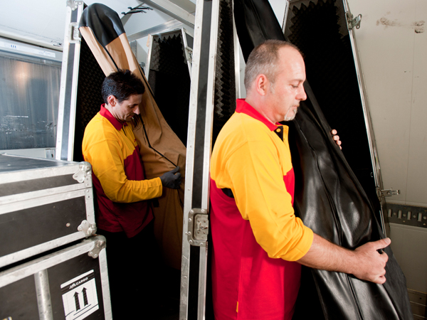 Many of the orchestra's instruments are highly sensitive and irreplaceable. DHL Trade Fairs & Events uses special shock proof transport boxes that monitor the instruments' temperature.