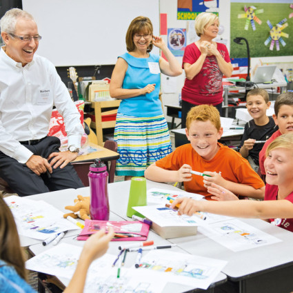 Norbert Koll, President of Henkel Consumer Goods Inc., meets with students at a school in Scottsdale, Arizona.