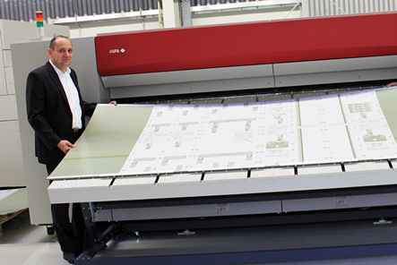 Markus Permesang next to the 48-up platesetter from Agfa Graphics