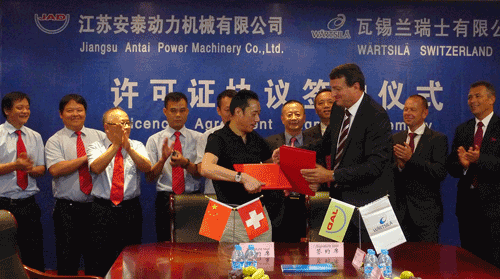 The agreement was signed by Mr Chen Guochong, Chairman JAD and Mr Martin Wernli, Vice President, 2-stroke, Wärtsilä Ship Power and Managing Director of Wärtsilä in Switzerland.