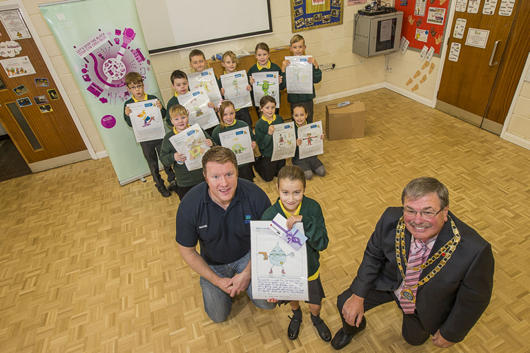 Dwr Cymru Welsh Water Stop the Block competition winners. Pupils from Ysgol Escob Morgan in St Asaph. Rhodri Sellers from Welsh Water and the Mayor of St Asaph, Cllr Peter Scott were at the school to present prizes to runners up and the winner Erin Jones, 9.
