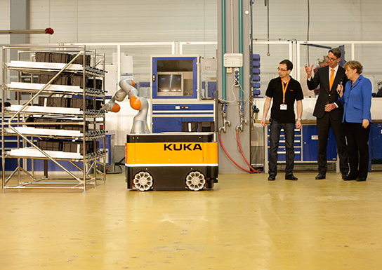 German Chancellor Angela Merkel visited KUKA in Augsburg to discuss the factory of the future
