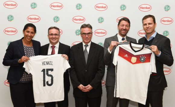 Steffi Jones, Carsten Knobel, Helmut Sandrock, Kasper Rorsted and Oliver Bierhoff at the press conference as the jerseys are handed over.