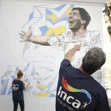 Barcelona footballer Luis Suarez immortalized in AkzoNobel paint on the walls of his old school in Montevideo, Uruguay
