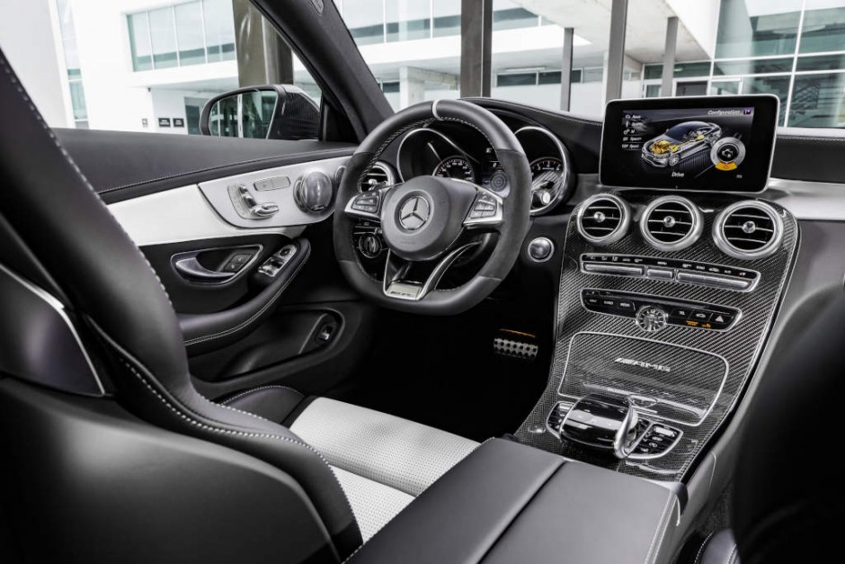 """Mercedes-AMG C 63 S Coupé, interior: leather crystal grey/black, AMG Performance steering wheel in black nappa leather/DINAMICA microfibre in a 3-spoke design, with flattened bottom section, 12 o'clock marking in black, steering wheel bezel in silver chrome with """"AMG"""" lettering and silver-coloured aluminium shift paddles, AMG carbon-fibre/light longitudinal-grain aluminum trim"""