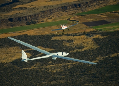 The Perlan 2 glider performs its maiden flight soaring 5,000 feet above Roberts Field in Redmond, Oregon.