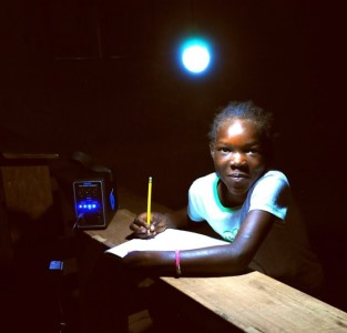 A child using an energy kiosk in Kenya