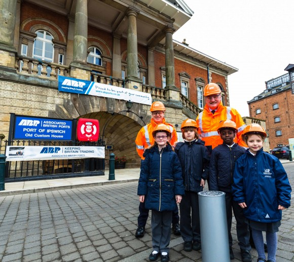 Children from St Mark's Catholic Primary School who were involved making items that were placed inside the time capsule are pictured with Andrew Harston (back right) Director of Shortsea Ports, Associated British Ports and Ben Gummer MP, together with the time capsule ahead of it being lifted to the clock tower of ABP's Old Custom House, Suffolk, United Kingdom on 18-March-2016.