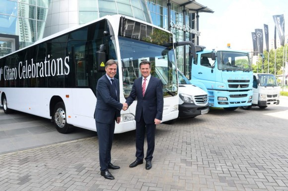 Dr. Wolfgang Bernhard, responsible for Trucks & Buses in Daimler's Board of Management, and Kai-Wolf Ahlden, Head of Daimler's regional center for South East Asia at the handover of the 1000th Mercedes-Benz Citaro city bus in Singapore