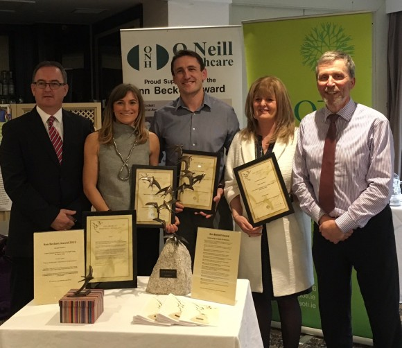 Claire Gleeson, Kieran Lewis and Dr Clodagh Nolan, Trinity occupational therapists with Career Pathways at the presentation of the Ann Beckett Award at the AOTI National Seminar Day are congratulated by John O'Neil, O'Neill Healthcare, award sponsors (left) and Andrew Semple, Head of the AOTI Ann Beckett Committee (far right)