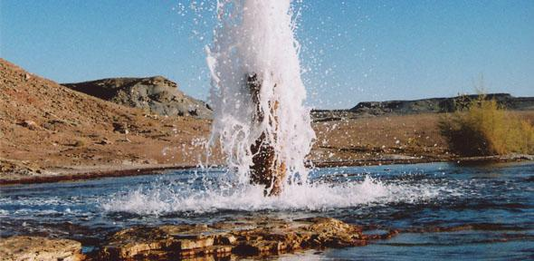 Image shows a cold water geyser driven by carbon dioxide erupting from an unplugged oil exploration well drilled in 1936 into a natural CO2 reservoir in Utah. Credit: Professor Mike Bickle
