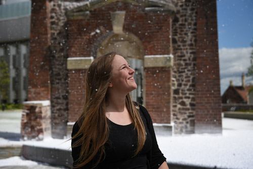 Student Lizzie Mould in the snow she created for Snow Business