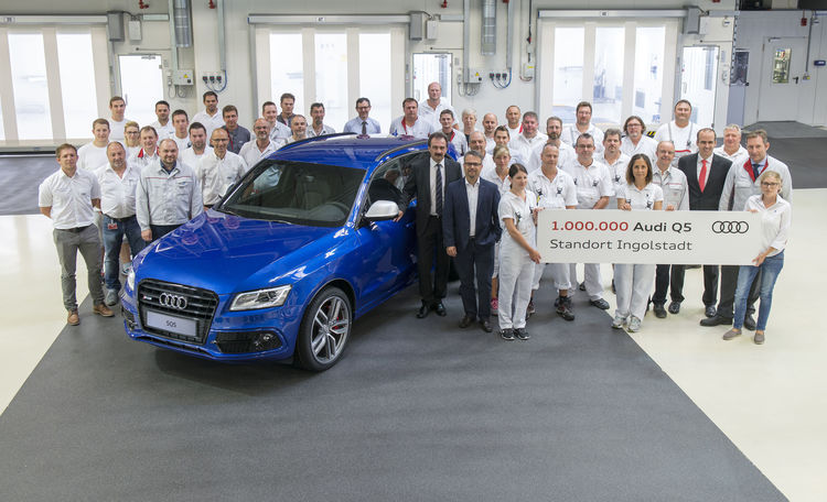 A production milestone has been reached at the Audi plant in Ingolstadt: The millionth Audi Q5 drove off the assembly line at Audi's main plant in Ingolstadt. Employees and management are pleased about the SUV-models' international success. Picture: Plant Director Albert Mayer (front right next to the anniversary car) and Chairman of Audi's General Works Council Peter Mosch (on Mr Mayer's right) with A4/A5/Q5 production employees.
