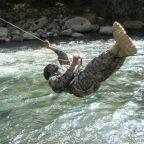 Afghan border police officer conducts river crossing at Karatag during a patrol leadership course, Gissar, Tajikistan, 25 May 2016. (OSCE/Firdavs Kurbanov)