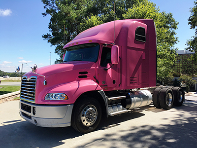 Mack Trucks with pink Mack® Pinnacle™ axle back model during breast cancer awareness month