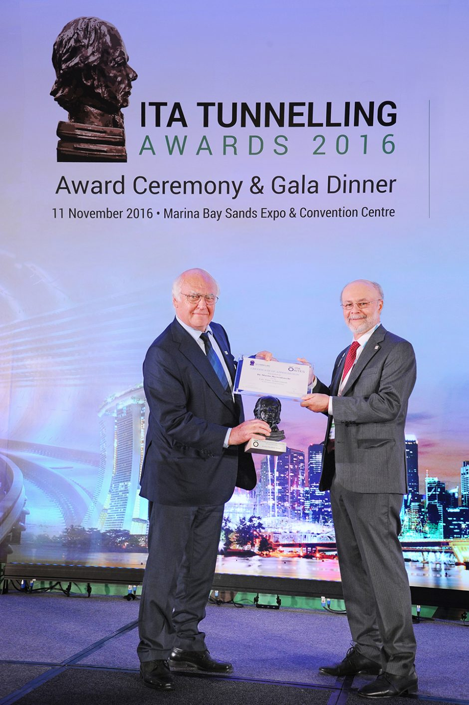"ITA President Tarcisio Celestino presents Dr.-Ing. E.h. Martin Herrenknecht the ""ITA Lifetime Achievement Award"" for his outstanding achievements in tunnelling."